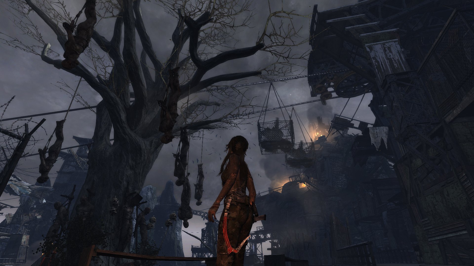 Lara Croft and corpses hanging from a tree.