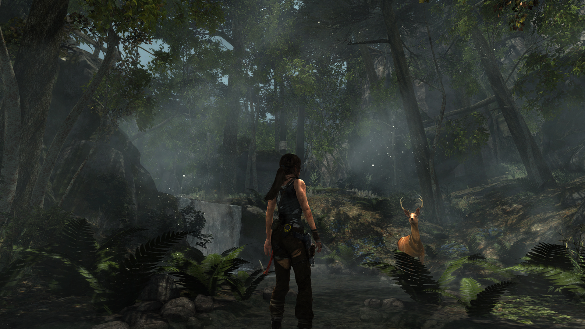 Lara Croft and a deer in a forest.