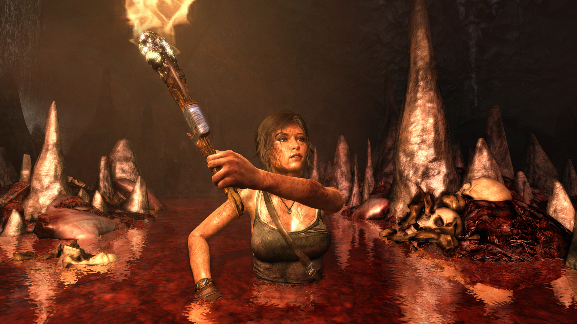 Lara Croft exploring a bloody and sinister cave.