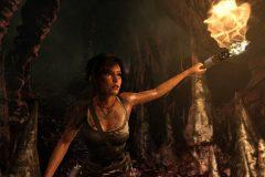 Lara Croft explores a cave.