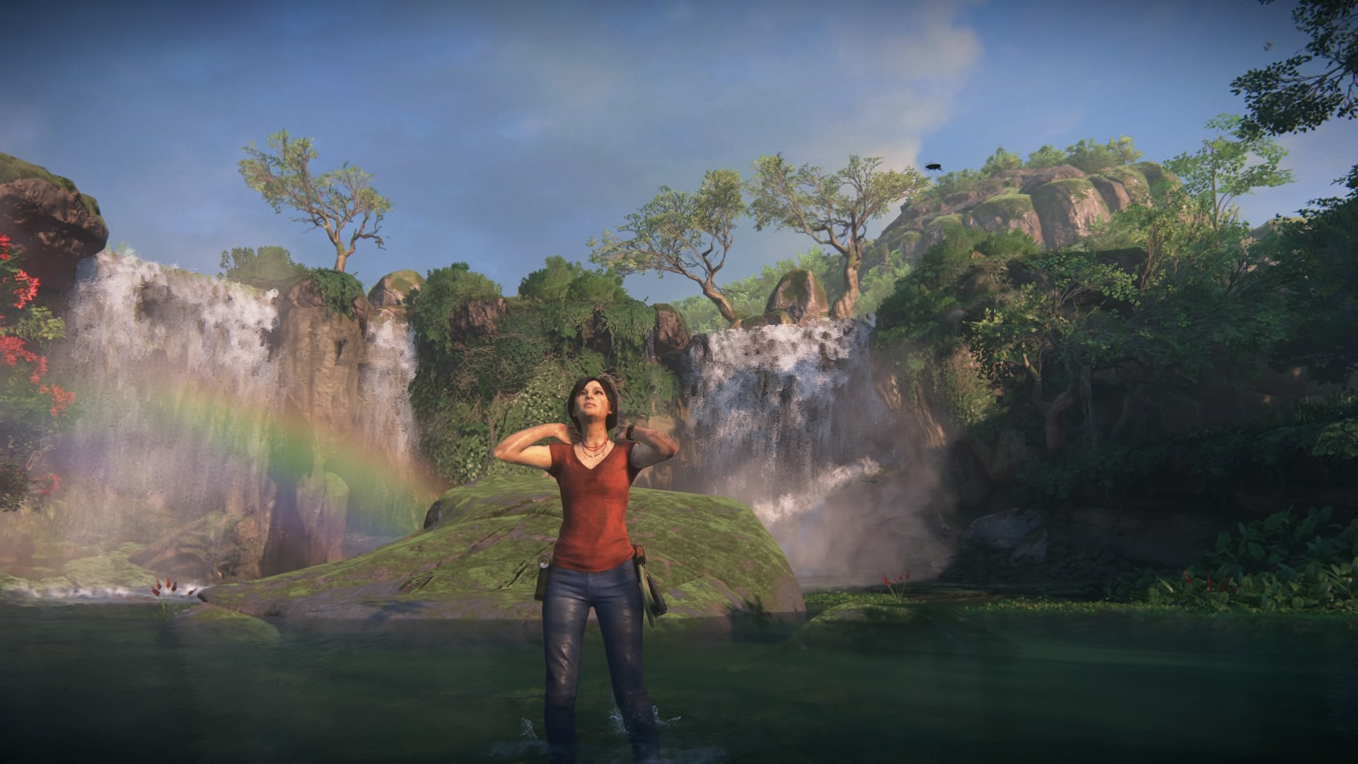 Chloe enjoying the weather. Rainbow in the background.
