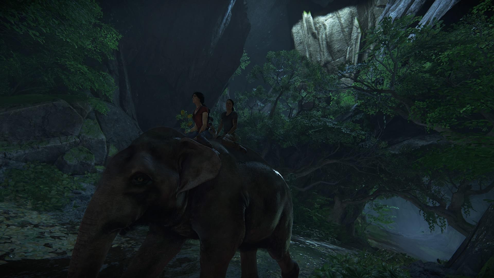 Chloe and Nadine riding an elephant.